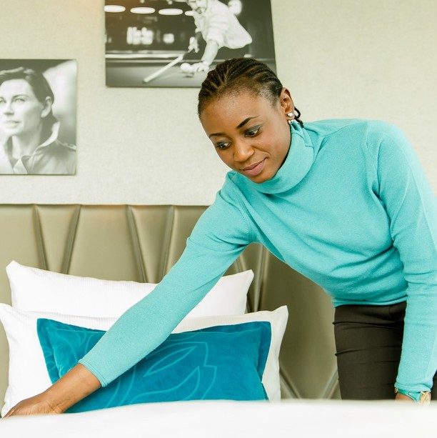 Housekeeper in a Motel One hotel room