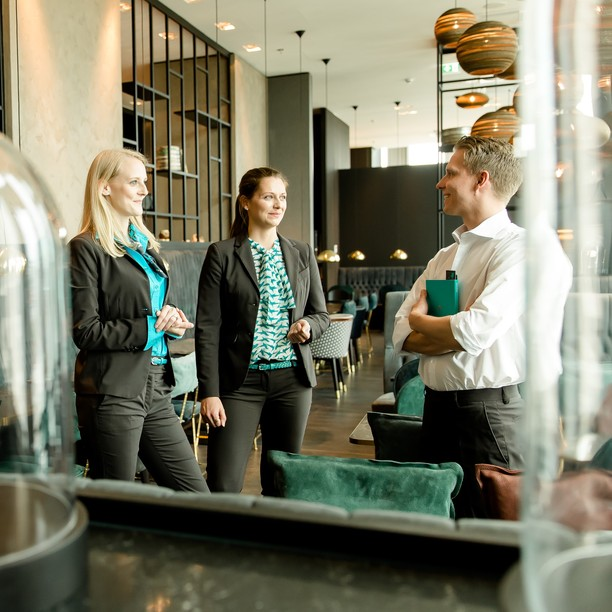 Sales Manager show the customer the Motel One Design